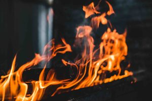Photo by btxstudio/Fotolia. Fire burning on the grill.