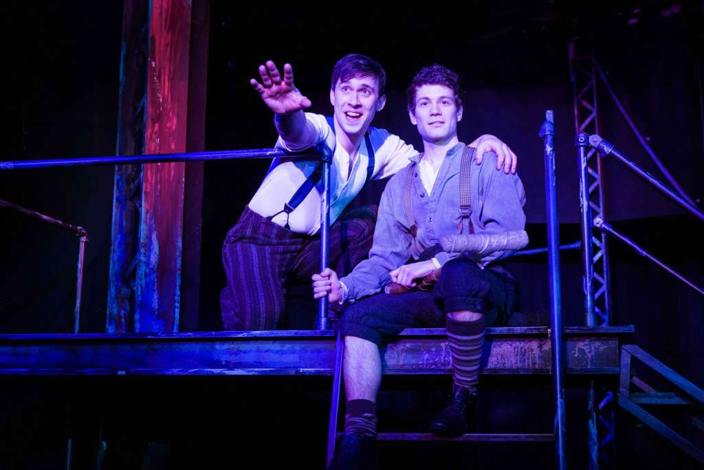 """Jack sings about Santa Fe to Crutchie as they gaze out into the distance, imagining it. Photo by Rich Ryan Photography, 2018, for Chanhassen Dinner Theatres' """"Newsies."""""""