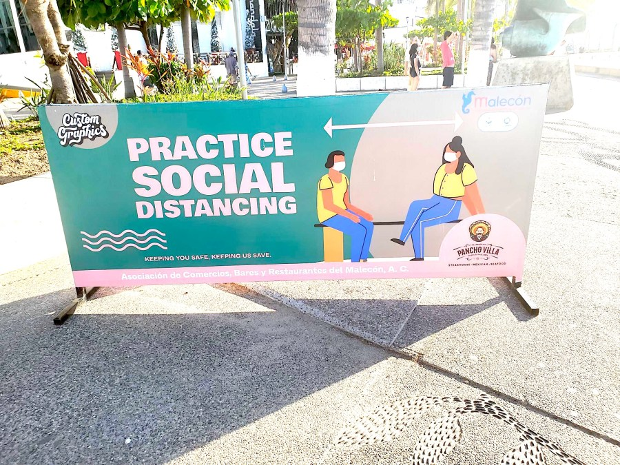 Sign at the Puerto Vallarta Malecón Reminding People to Social Distance