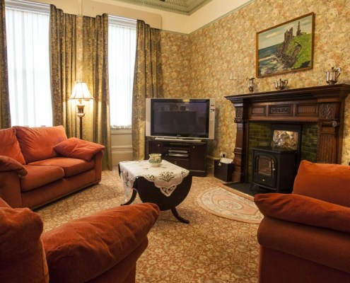 Main lounge in large period style 3 bed accommodation