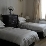 Twin bed in 2 bed rental apartment accommodation