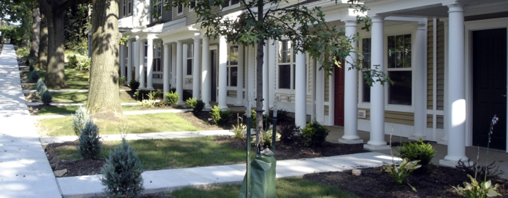 Example: A Concrete Path Leads from the Sidewalk to Each Front Door in a Row of Visitable Townhouses
