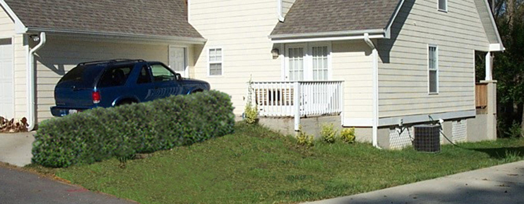 Example: An accessible Entrance is Provided by a Concrete Path Leading  from the Driveway to the Back Entrance
