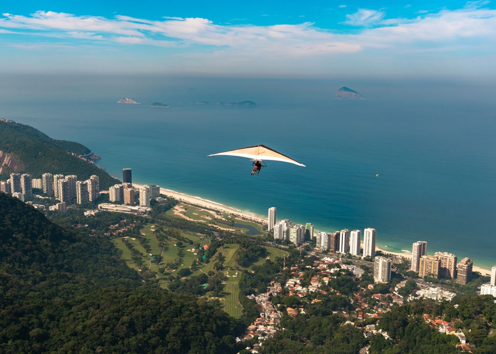 Hang gliding off Pedra Bonita is a popular thrill-seeking activity. Overlooking Rio de Janeiro, Brazil