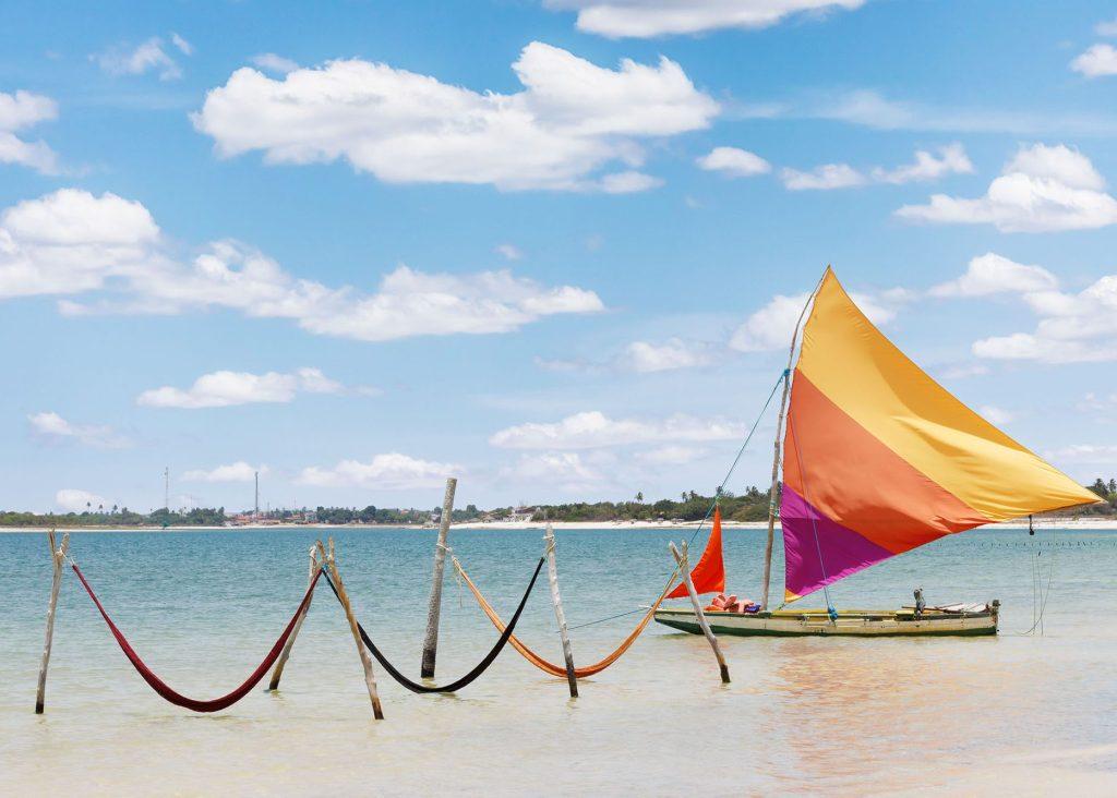 beautiful sail boat and hammocks at the Paradise Lake (Jericoacoara, Brazil)