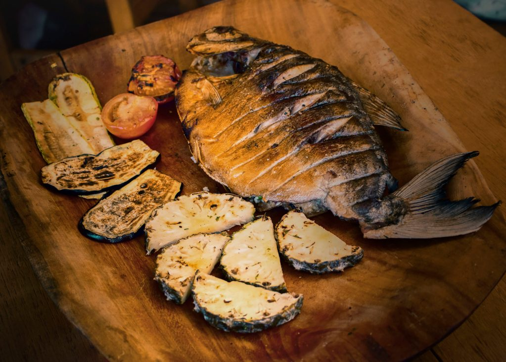 """The Amazonian fish called """"Pacu"""" is served in a wooden tray"""