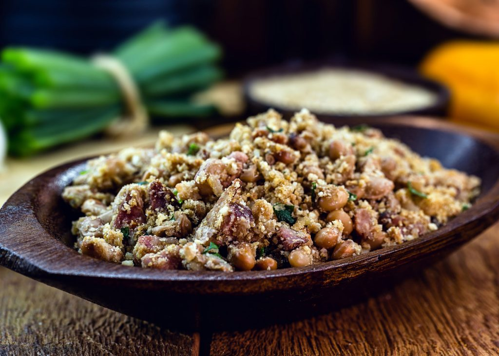 """Beans with pork, called """"tropeiro beans"""" in Brazil, typical Brazilian food."""
