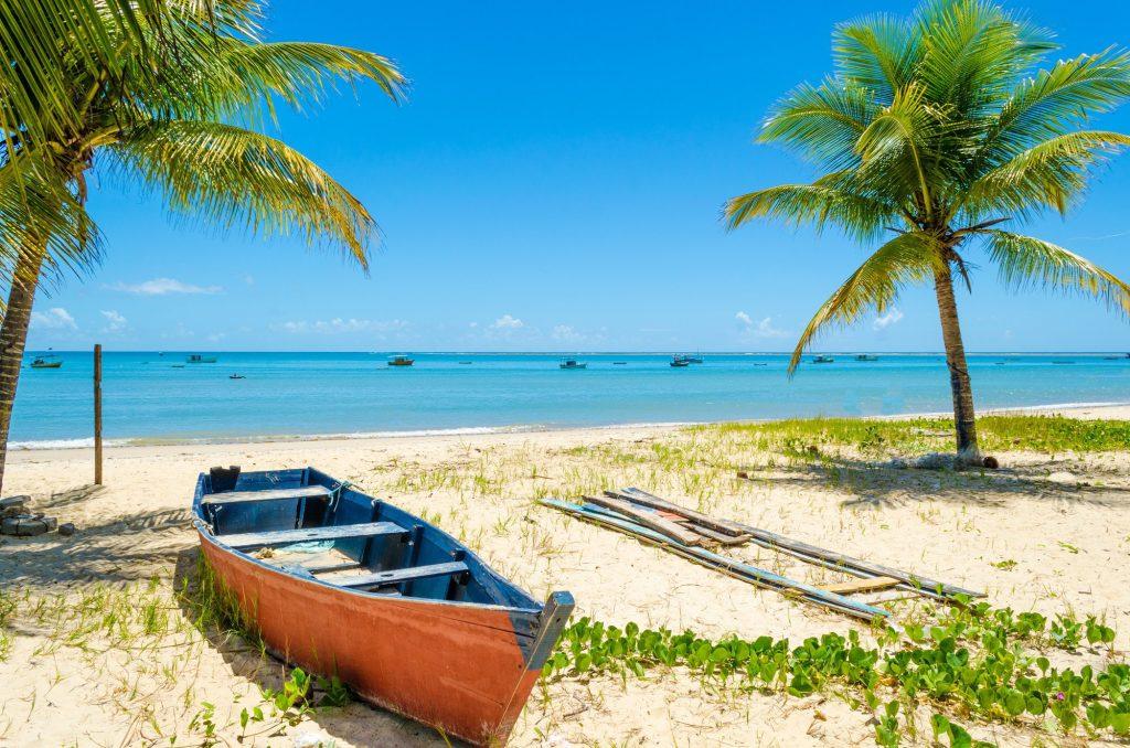 tropical concept. Wooden canoe. Porto Seguro, bahia, Brazil.