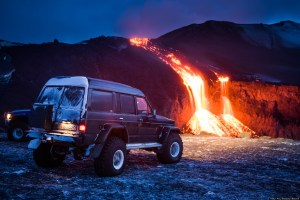 Cars Line Up In The Path Of Volcanic Eruption