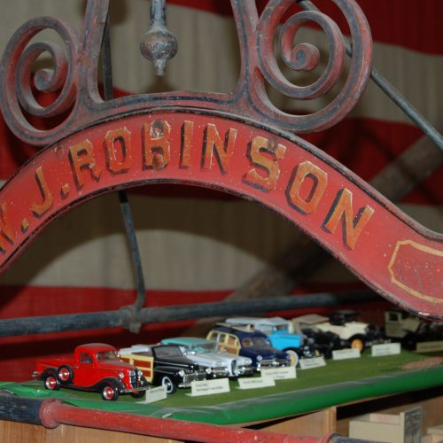 W.J. Robinson Sign over historic miniature model cars