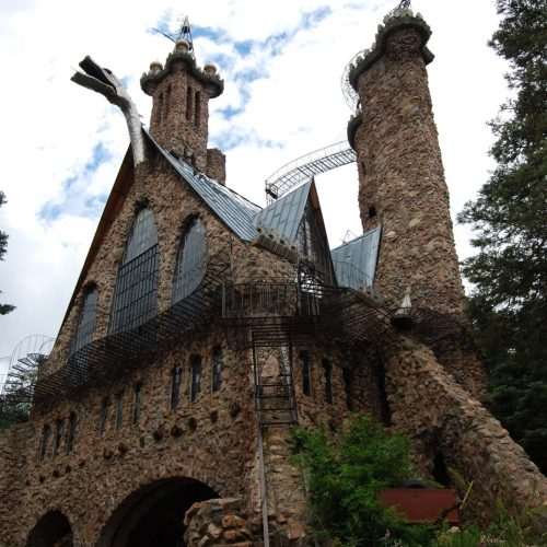 Bishop Castle set back in a wooded area