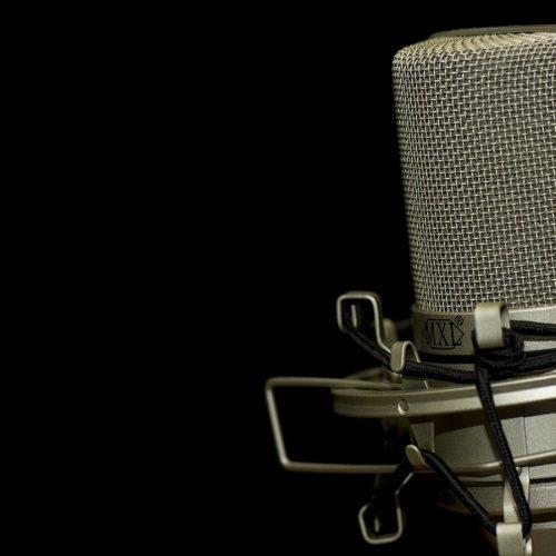 Radio DJ Microphone against studio backdrop