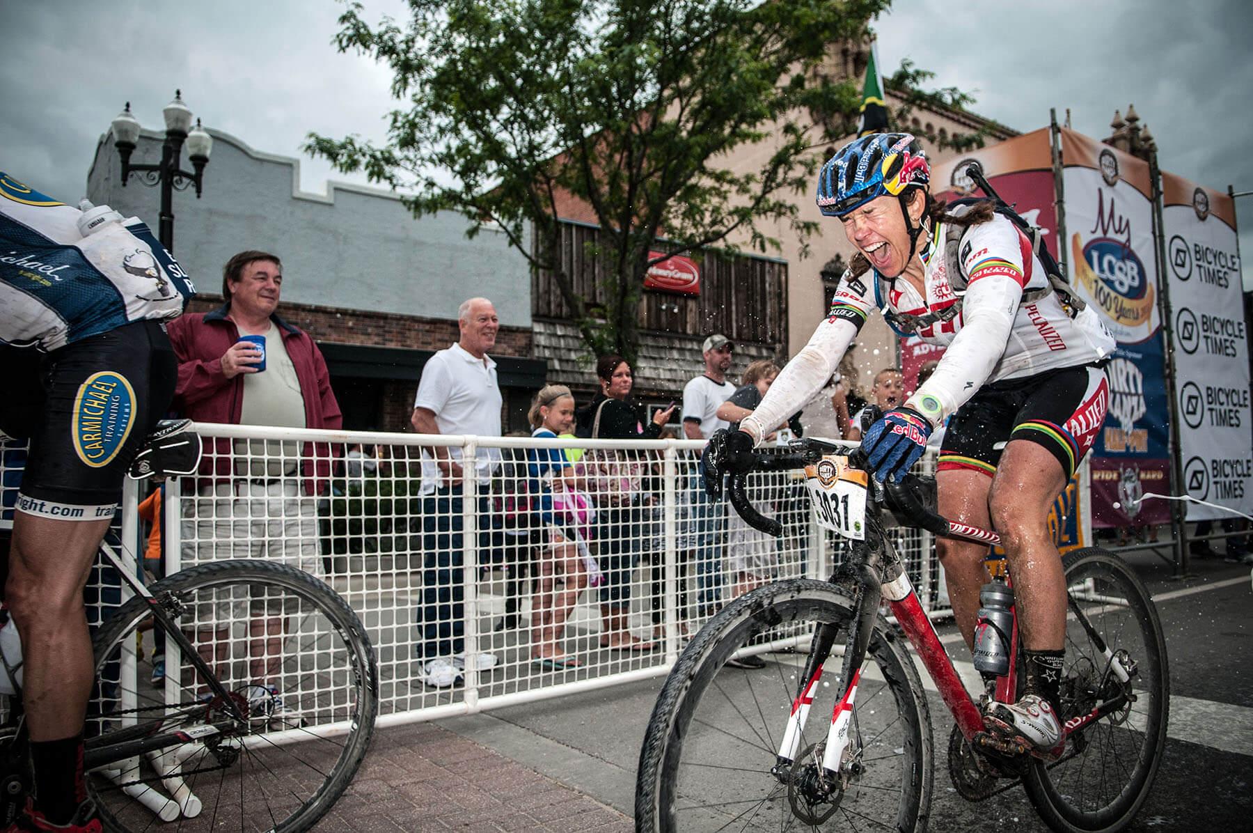 Champion endurance cyclist Rebecca Rusch crossing the Dirty Kanza finish line