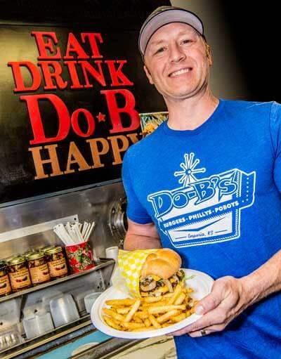 Daryn Bontrager serving a Do-B's burger