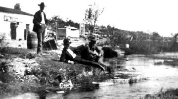 Relaxing in front of Koehler's Store along Comanche Springs, circa 1900