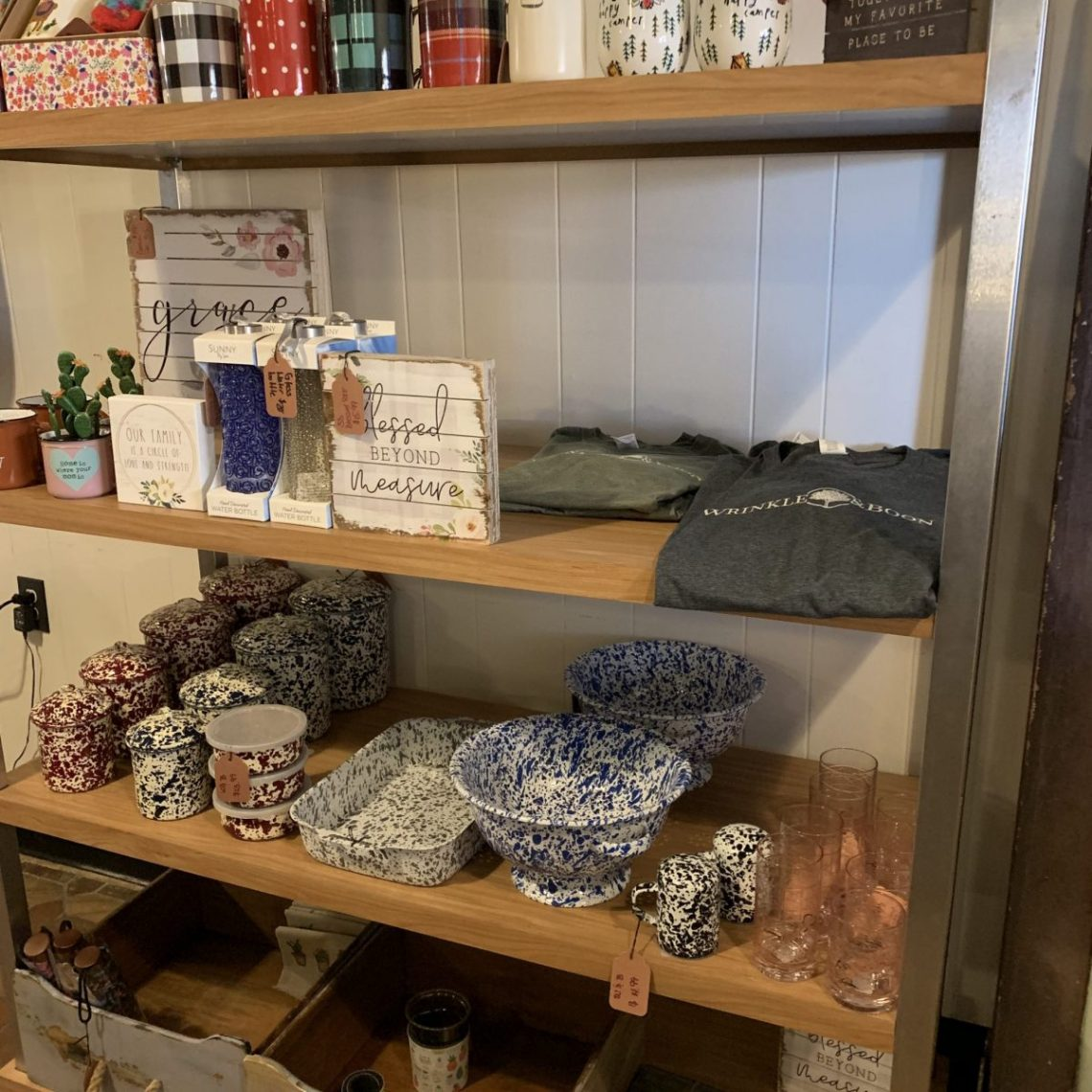 decorative signs, a wrinkle and boon t-shirt, bowls, and mugs