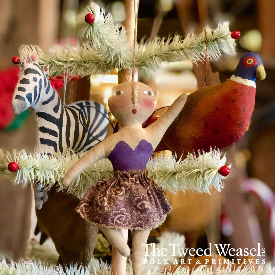 homemade Christmas ornaments of a ballerina, a zebra, and a bird