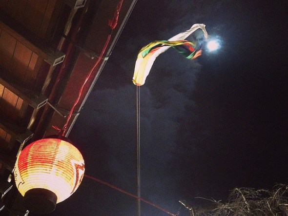 Colorful streamer flying above the temple in the moonlight