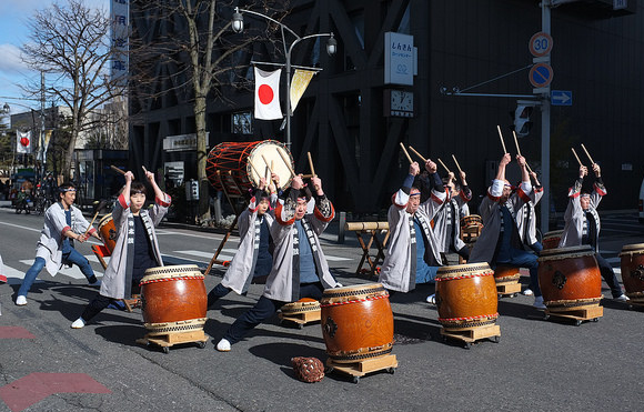 A taiko group performing in the street