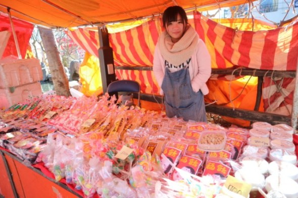 A girl selling traditional candies