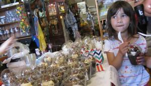 Girl choosing a chocolate treat at Chocolate Stroll 2015