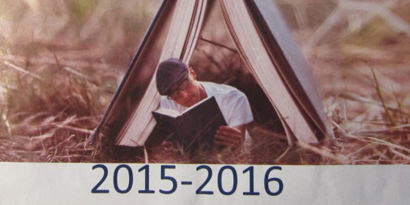 Photo of Man reading book, displayed for the Cole Library 2015-2016 Book Group Selections