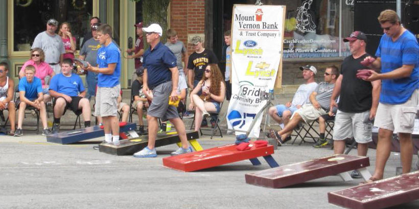 Photo of participants and audience for Bags Tournament at Mount Vernon Iowa Heritage Days
