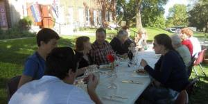 Potluck Grant Dinner Outside First Street Community Center