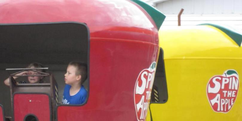 Children enjoying a carnival ride at Mount Vernon Heritage Days