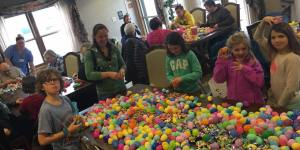 Children Stuffing Colored Eggs with Candy for Easter Egg Das