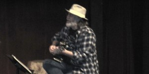 Dale Beeks playing guitar in Balderdash Ditty