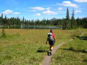 A hiker approaching Mystic Lake © Craig Romano