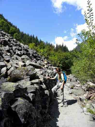 A hiker admires the great talus wall © Craig Romano
