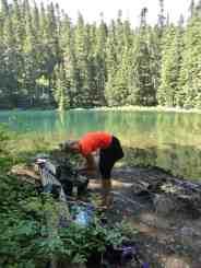 A hiker takes a beark at Lake West © Craig Romano