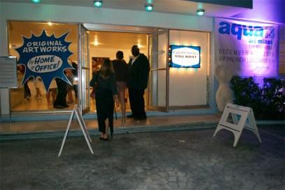 Charlie James Gallery Works on Aqua Hotel Front Windows at Aqua Fair 2013 B by Margery Gordon 1