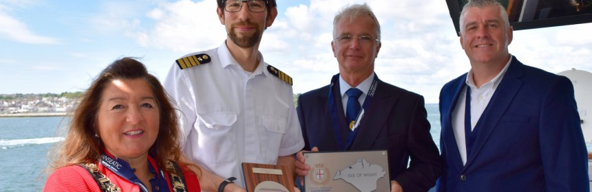receiving a plaque onboard the Hanseatic Nature