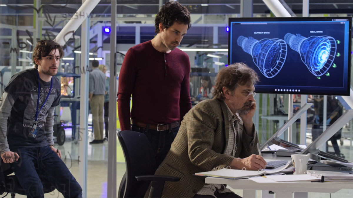 Darius and the team studying the EM drive on screen in the design room in Salvation (2017)