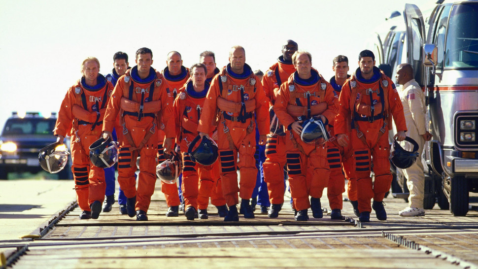 Scene from Armageddon (1998) showing the members of the two shuttle crews walking on the tarmac. In blog Making an Impact: Lights, Camera and Asteroid! which is about asteroid impacts and comet impacts on Earth.