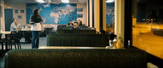 JT (Paul Williams) tracks down Delores Summers (Delanna Studi) working as a waitress at a remote aerodrome.