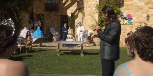 Goliath Season 2: LA mayoral candidate Marisol Silva (Claudia Quintero) takes Billy McBride to meet her brother Gabriel Ortega at a quinceañera. Credit: Amazon Studios