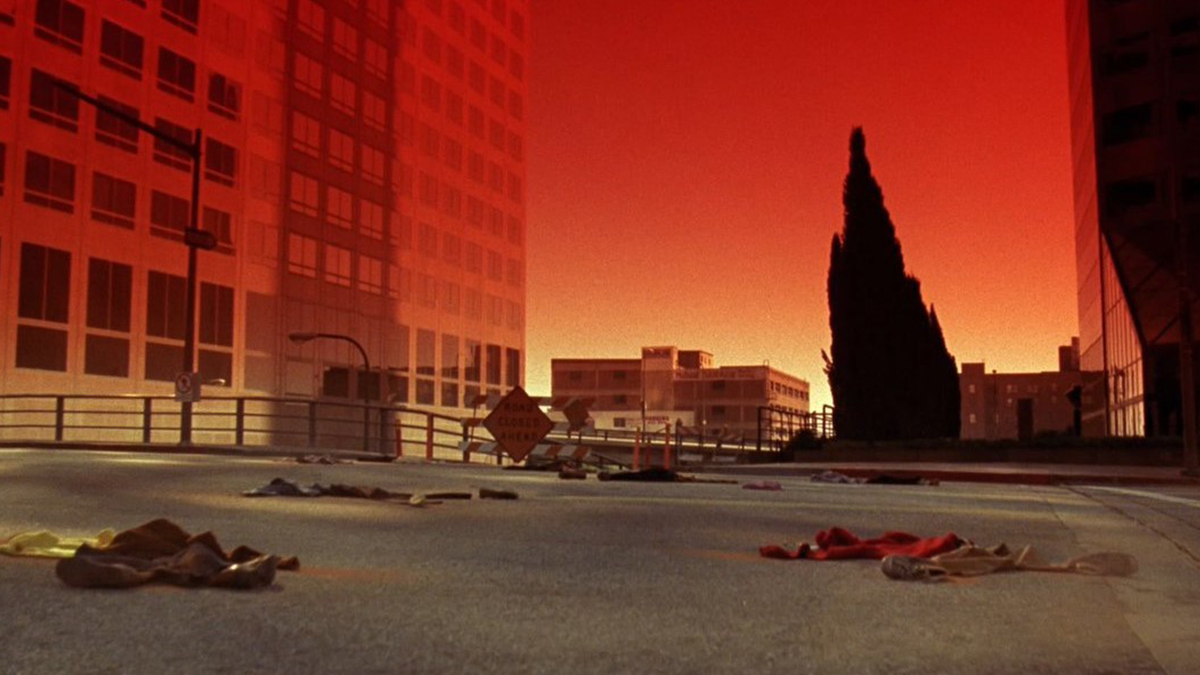 Scene from Night of the Comet (1984) showing the red haze and piles of dust in a deserted street.