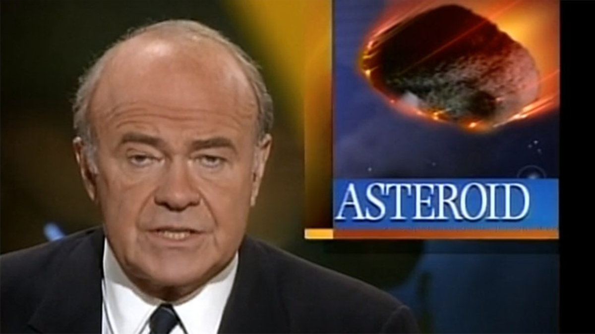Scene showing news anchor and image of asteroid in movie Without Warning (1994)