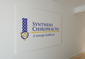 Synthesis Chiropractic Logo on wall
