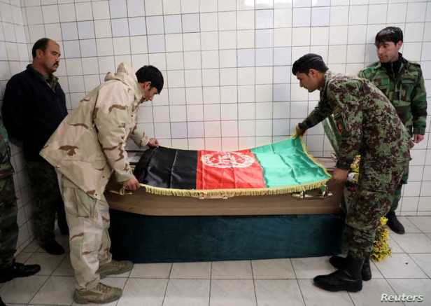 Afghan National Army soldiers put flag of Afghanistan on the coffin of Japanese doctor Tetsu Nakamura, at a Hospital in Kabul,…