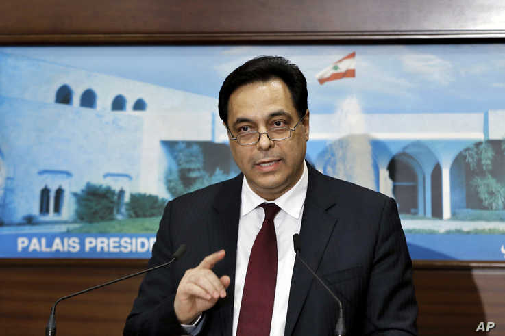 Lebanese Prime Minister Hassan Diab speaks during a news conference after his government was announced, at the Presidential…