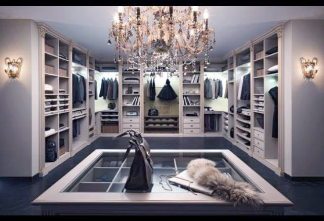 This-dreamy-dressing-room-is-of-epic-proportion-and-luxurious-design-we-alwaysinclude-an-island-for-packing-and-organizing-and-this-glass-top-allows-her-to-see-accessories-inside