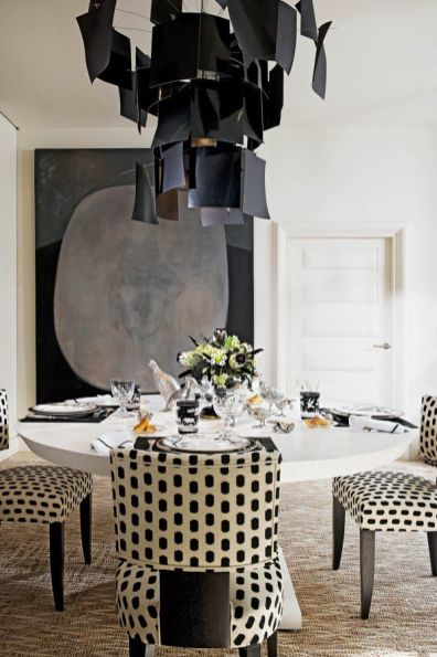 This dramatic piece is a contemporary nod to the incredible artist, Calder. I like that they chose to use a fun and whimsical pattern on the dining chairs to break up the rather sexy and serious black color in the art and chandelier.