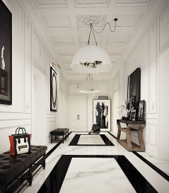 Stark white walls, white marble and the white industrial-inspired lighting makes this otherwise formal entrance hall very contemporary and clean.