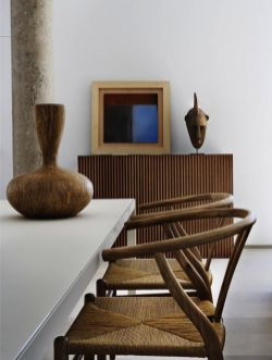 Using tribal art with classic Asian chairs creates a zen moment in this urban dining room.