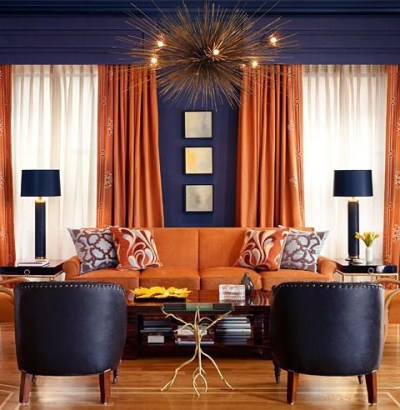 Orange curtains and upholstery against dark grey walls is an excellent pairing that reads both masculine and elegant